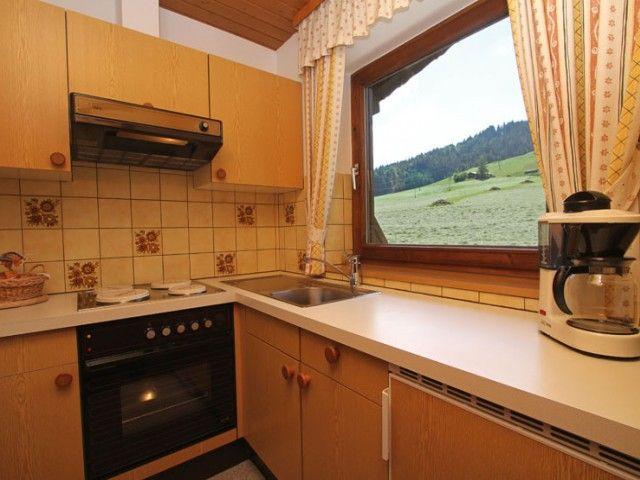 Küche - Ferienwohnungen Kröpflhof St. Jakob i. H.